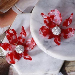 lele sadoughi Natural resin lily flower earrings